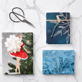 Beautiful ballerina in a red dress wrapping paper sheets