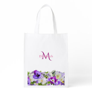 Monogram and violet pansies flowers on white grocery bag